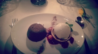 Dark chocolate fondant with fresh seasonal berries and vanilla bean ice-cream.