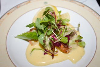 Grilled queen scallops with lemon-scented hollandaise sauce.