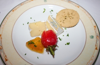 Boland Camembert style cheese with a blue vein , served with melon preserve, chives and rosemary infused savory shortbread.